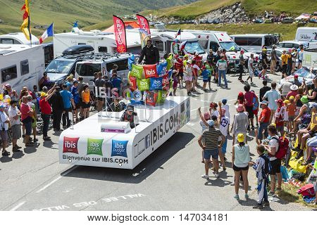 Col du Glandon France - July 23 2015: Ibis Budget Hotels truck during the passing of the Publicity Caravan on Col du Glandon in Alps during the stage 18 of Le Tour de France 2015. Ibis Budget Hotels is an international chain of cheap hotels.