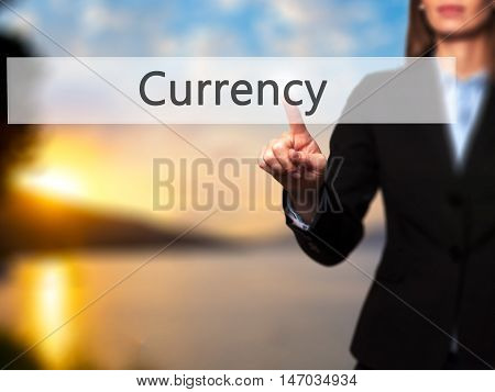 Currency - Businesswoman Pressing High Tech  Modern Button On A Virtual Background