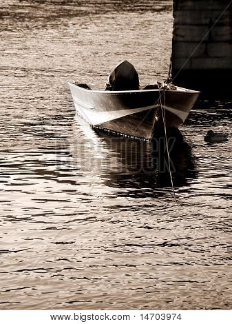 Boat Moored By Pier In Sea