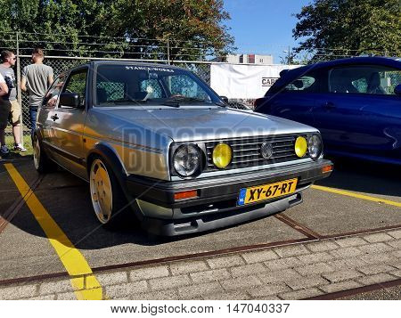 Amsterdam, The Netherlands - September 10, 2016: Blue Volkswagen Golf 40Kw U9 1990 On Display During
