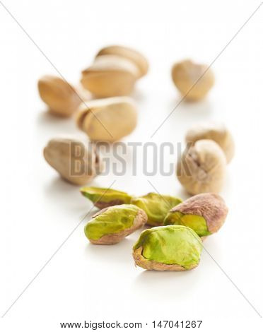 The pistachio nuts isolated on white background.