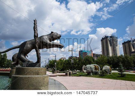 Astana, Kazakhstan, 27.08.2016 Animal statue jumping through the fire near the Circus