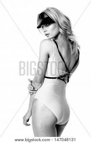 Blonde girl wearing bodysuit and black leather belt and visor, black and white photo