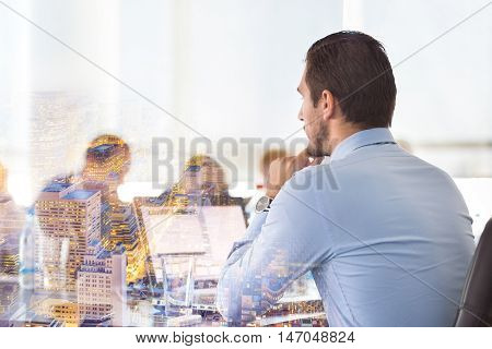 Corporate business meeting in office. Business executive giving instructions to his colleagues. Explaining business plans to employees. Business team concept. Business and Entrepreneurship.