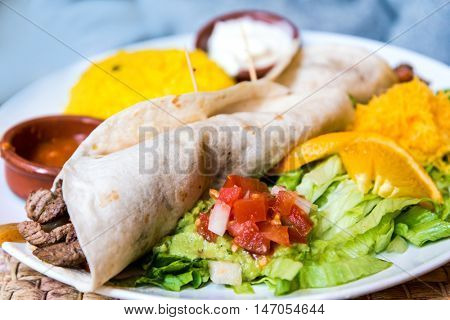 beef tacos served with lettuce and fresh tomatoes