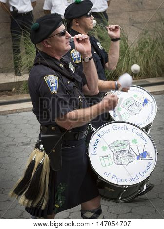 NEW YORK-SEPT 9 2016: Boston Gaelic Pipes & Drums perform in the NYPD Emerald Society Pipe and Drums 9/11 Memorial Procession on the 15th anniversary of the terror attacks.