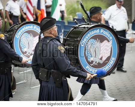 NEW YORK-SEPT 9 2016: Cleveland Police Pipes and Drums perform in the NYPD Emerald Society Pipe and Drums 9/11 Memorial Procession on the 15th anniversary of the terror attacks.
