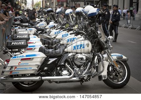 NEW YORK-SEPT 9 2016: Motorcycles from the NY Police Department lined up on Broadway at the NYPD Emerald Society Pipe and Drums 9/11 Memorial Procession on the 15th anniversary of the terror attacks.