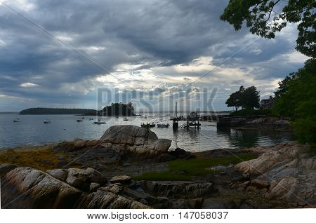 Silhouetted views of Little Bustin's Island in Casco Bay in Maine.