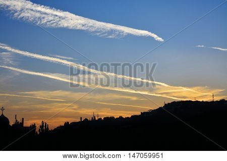 Beautiful clouds on the sky at sunset with contrails - chemtrails