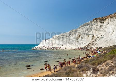 Scala dei Turchi (Sicily, Italy) - 28 AUGUST 2016: Crowded Beach of Scala dei Turchi in high season (Expectation Vs. Reality)