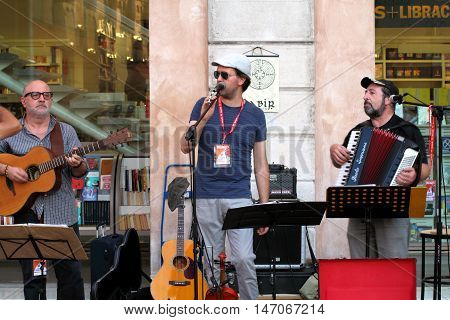Ferrara, Italia - August 25, 2016: The Ferrara Buskers Festival is dedicated to the art of the street. Labìr is a progressive-folk trio, they want to pay homage to the greats of the progressive groups of the '70s (Genesis, Pink Floyd, Led Zeppelin, Jethro
