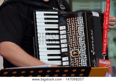 Ferrara, Italia - August 25, 2016: The Ferrara Buskers Festival is dedicated to the art of the street. A small detail of a Soprani accordion used by a street band