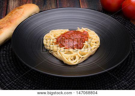I love pasta Spaghetti heart with marinara on a black dish