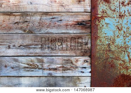 Wooden Wall with a Old Blank Metal Rusty Placard