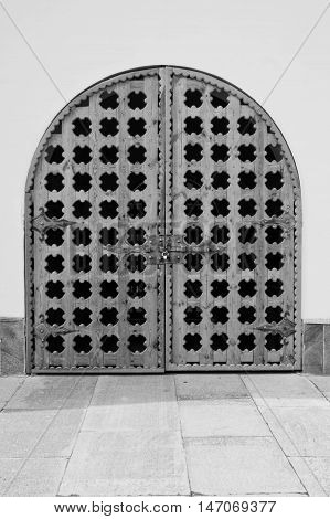Old Wooden Gate In The Wall Of A Building Black And White