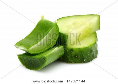 Fresh leaves of aloe Vera and slices of cucumber close-up.