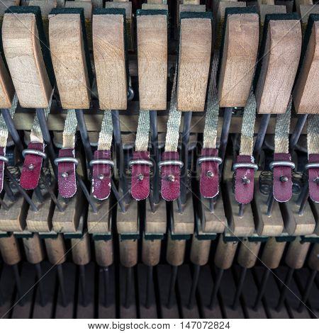 inside a piano, wooden parts, mechanisms closeup