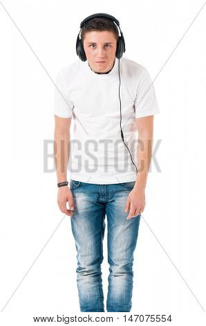 Teen student boy with headphones listening music. Full lenght portrait of shocked teenager isolated over white background.