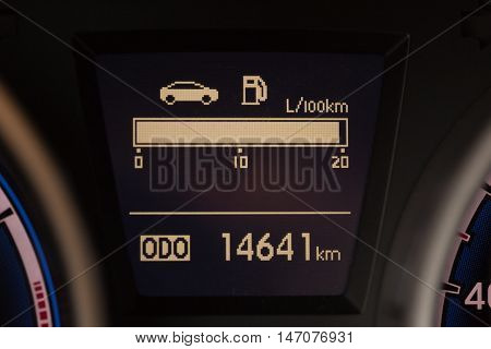 Closeup Detail of a Digital Fuel Gauge and Odometer