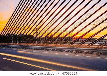 Shrouds Of Vansu Bridge, formerly Gorky Bridge, In Riga, Latvia. Shroud Bridge. Summer Evening With Blue. 595 Meters In Length. Vansu Bridge - One Of The Symbols Of Modern Riga