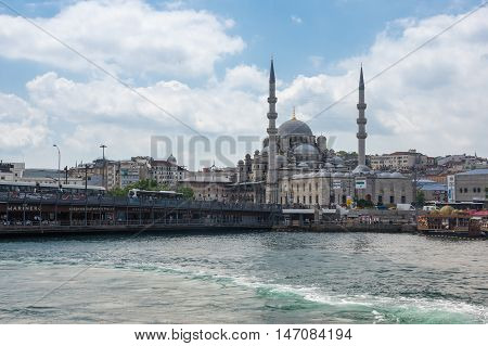 ISTANBUL TURKEY - JUNE 25 2015: View on Galata bridge and New Mosque in Eminonu Istanbul Turkey