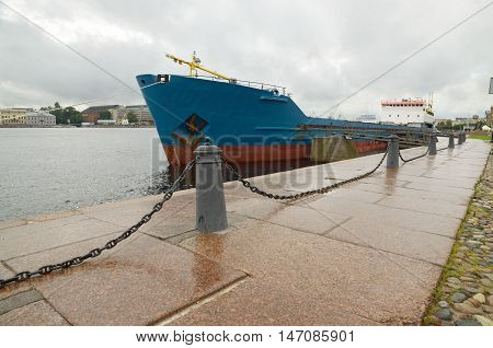 At granite town quay moored cargo ship.