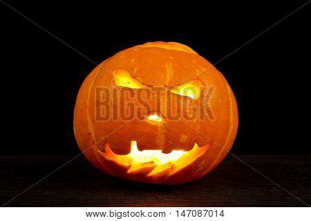 Halloween Pumpkin  orange face isolated dark background