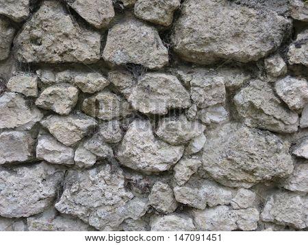 Stenen muur van een kasteel (detailfoto) goed voor achtergronden