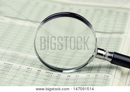 Financial Data See Through of Loupe on Financial Document - Close Up
