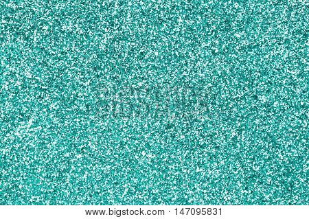 Teal green or turquoise and aqua glitter sparkle background texture or mint color party invitation
