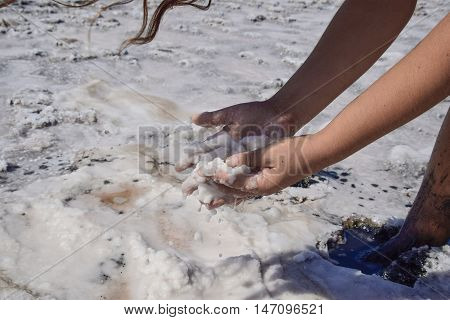 Hands Girls Taking On The Wet Salt From The Puddles