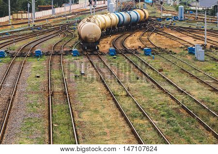 Group of moving cisterns at station by rail