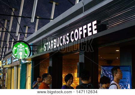Shanghai, China - circa June 2016: Starbucks Coffee shop with customers waiting in line in Shanghai airport, China. Starbucks Coffee is an American coffeehouse chain operating worldwide including over 2000 shops in the mainland China.
