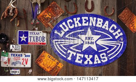 LUCKENBACH, TEXAS - APRIL 7: Town sign and memorabilia on wooden barn in historic Luckenbach, Texas on April 7th, 2016.