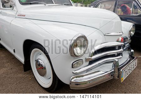 Kharkiv Ukraine - May 22 2016: Soviet retro car white GAZ M20 Pobeda Third Series manufactured between 1955 and 1958 exhibited at the festival of vintage cars Kharkiv Retro Rally - 2016 in Kharkiv Ukraine on May 22 2016