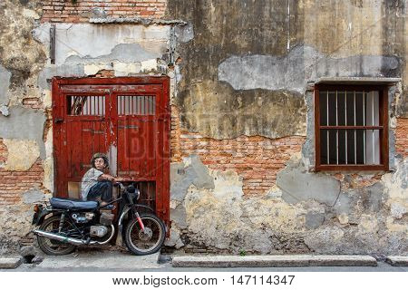 Georgetown Penang Malaysia - APRIL 15 2016: Street Mural entitled 'Boy on a bike; and a boy and his kite' painted by Ernest Zacharevic in Penang