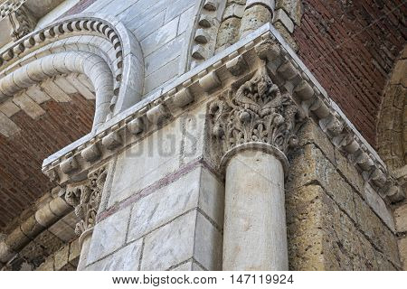 Brick and stone architectural details of Saint Sernin Basilica, Toulouse, France.