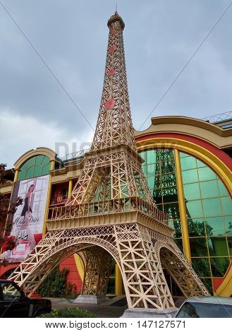 ALMATY KAZAKHSTAN - SEPTEMBER 12 2016: Reduced copy of Eiffel Tower on the street Furmanova. Almaty is the largest city in Kazakhstan and was the country's capital until 1997.