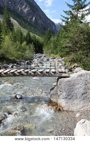Footbridge in Lechtal Valley in Tirol. Austria