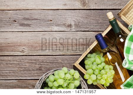 White wine and grapes on wooden table. Top view with copy space for your text