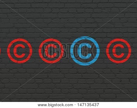 Law concept: row of Painted red copyright icons around blue copyright icon on Black Brick wall background