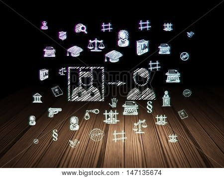 Law concept: Glowing Criminal Freed icon in grunge dark room with Wooden Floor, black background with  Hand Drawn Law Icons