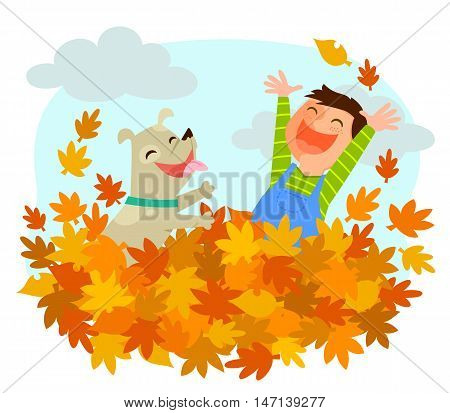 Boy and his dog playing in a pile of autumn leaves