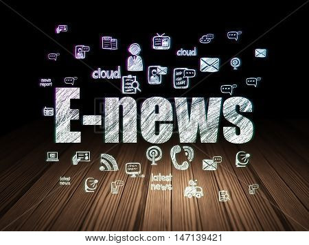 News concept: Glowing text E-news,  Hand Drawn News Icons in grunge dark room with Wooden Floor, black background