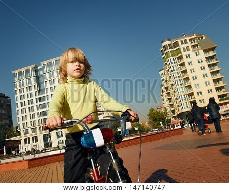 little happy boy on bike portrait. outdoor city Sofia Bulgaria