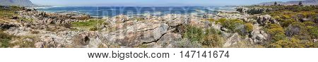 Wide panorama view of rocks and bay at Hermanus Western Cape South Africa known for whale watching