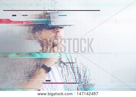 Man with VR goggles watching 360 video digital glitch effects added in post production.