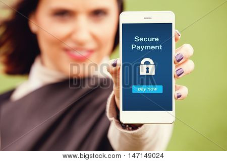 Mobile payment app. Woman holding a smart phone with secure payment app in the screen.