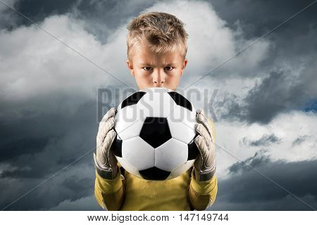 Aspiring young kid posing as a goal keeper.